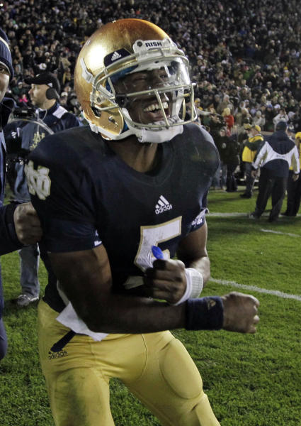 Notre Dame quarterback Everett Golson celebrates after scoring the game-winning touchdown in the third overtime period against Pittsburgh in an NCAA college football game in South Bend, Ind., Saturday, Nov. 3, 2012. Dame defeated Pittsburgh 29-26 in triple overtime. (AP Photo/Michael Conroy)