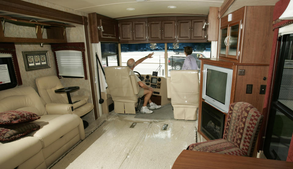 ** FILE ** Ron and Colleen Colbach check out a $223,000 Winnebago recreational vehicle at Motor Sportsland in Salt Lake City in this June 12, 2007 file photo.  The Colbachs divide their lives between Utah and Arizona.  Winnebago Industries Inc. on Thursday, Dec. 20, 2007 said its profit rose about 26 percent in the first quarter as more customers bought more profitable high-end motor homes and the company spent less on promotions. It also boosted its dividend and its shares rose more than 4 percent in morning trading. (AP Photo/Douglas C. Pizac, file)