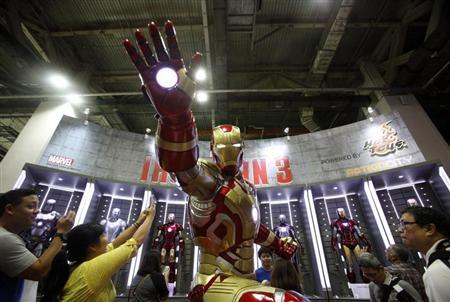 Visitors take photos of an Ironman exhibit at the Singapore Toy, Game and Comic Convention