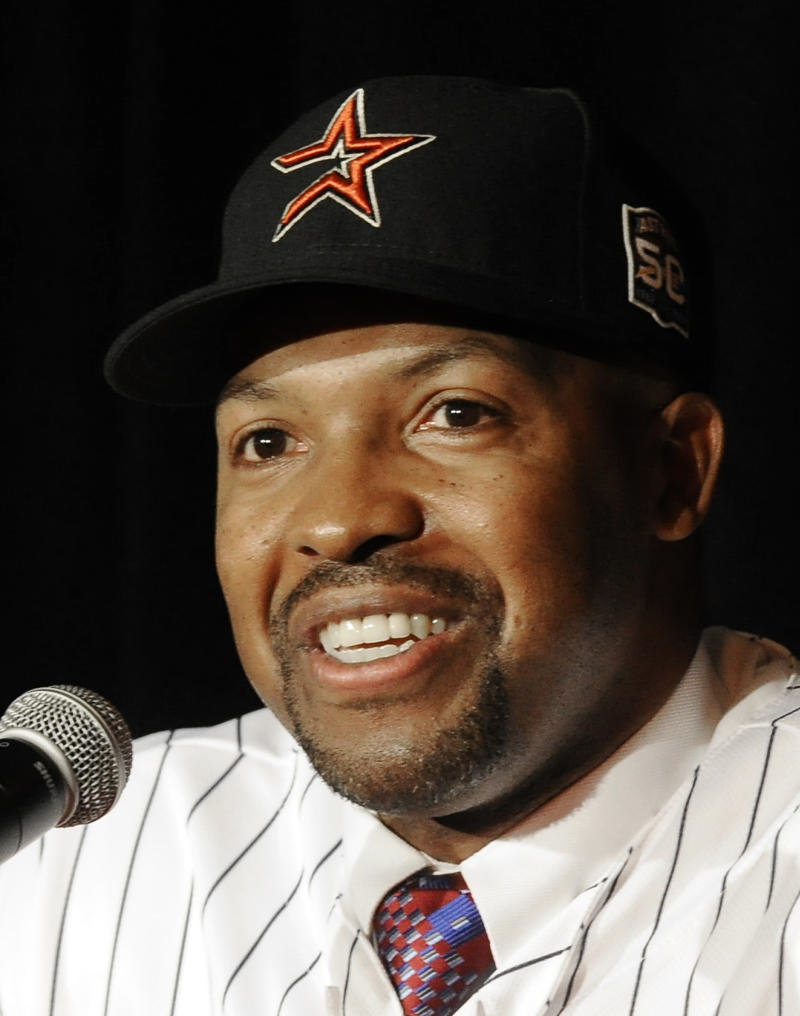 FILE - In this Oct. 18, 2012, file photo, the Houston Astros' new manager Bo Porter answers questions during a baseball news conference in Houston. The Astros have a grand total of five players with more than two years of major league experience, a first-year manager and a move to the American League to deal with, too. So how come they are so optimistic they can avoid becoming the first team in a half-century to lose 106 games in three consecutive seasons?  (AP Photo/Pat Sullivan, File)