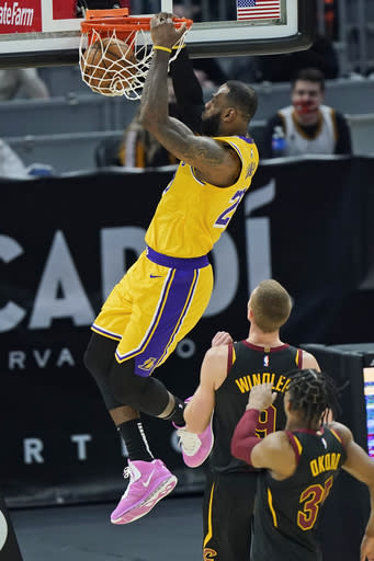 Los Angeles Lakers' LeBron James dunks the ball against the Cleveland Cavaliers in the first half of an NBA basketball game, Monday, Jan. 25, 2021, in Cleveland. (AP Photo/Tony Dejak)