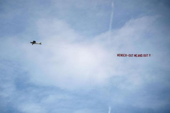A plane flew over Stoke's Bet365 Stadium in during a 2017 match calling for Wenger's exit (PA)