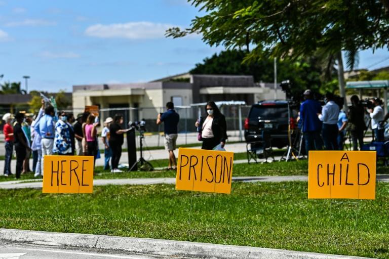 Demonstrators call for an end to the detention of unaccompanied minors arriving in the United States, outside a facility in Homestead, Florida previously used to hold undocumented children, on March 4, 2021