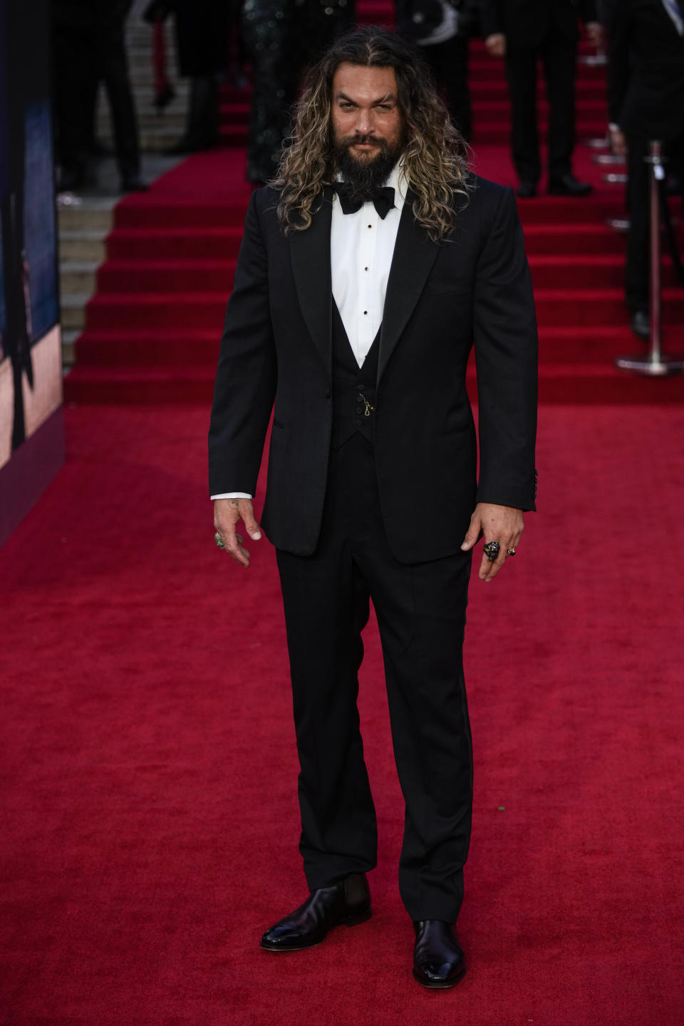 """Jason Momoa poses for photographers upon arrival for the world premiere of the new film from the James Bond franchise """"No Time To Die"""" in London, Tuesday, Sept. 28, 2021. (AP Photo/Matt Dunham)"""