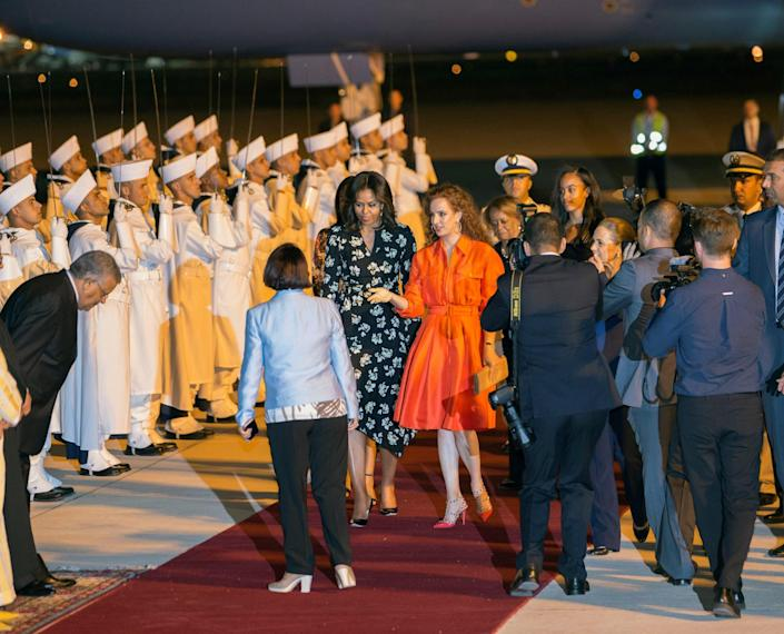 <p>U.S. first lady Michelle Obama (center left) is welcomed by Princess Lalla Salma of Morocco (center right) as she arrives at the Marrakech International airport, June 28, 2016. (REUTERS/Youssef Boudlal) </p>