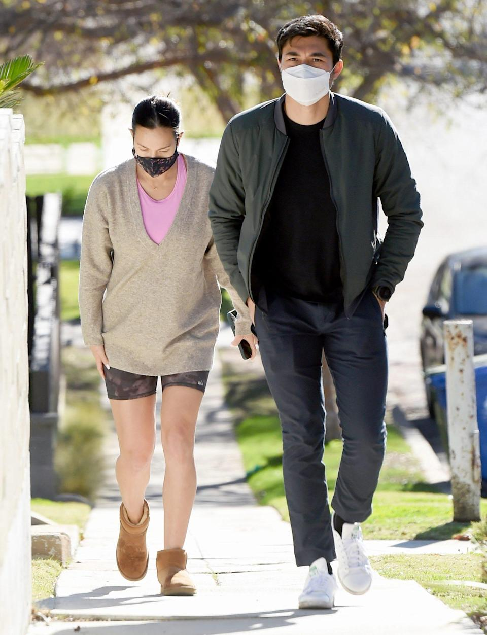 <p>Parents-to-be Henry Golding and Liv Lo go for a walk before grabbing a bite to eat out in L.A. on Monday.</p>