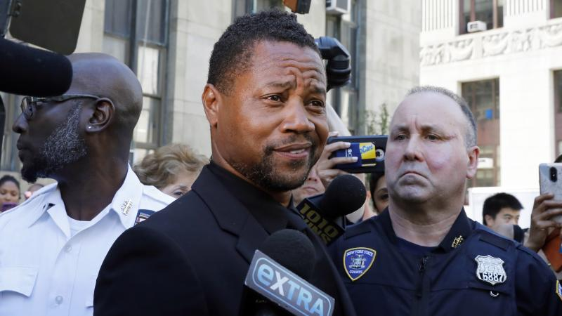 The actor denies claims he grabbed a woman's breast at a Manhattan bar.