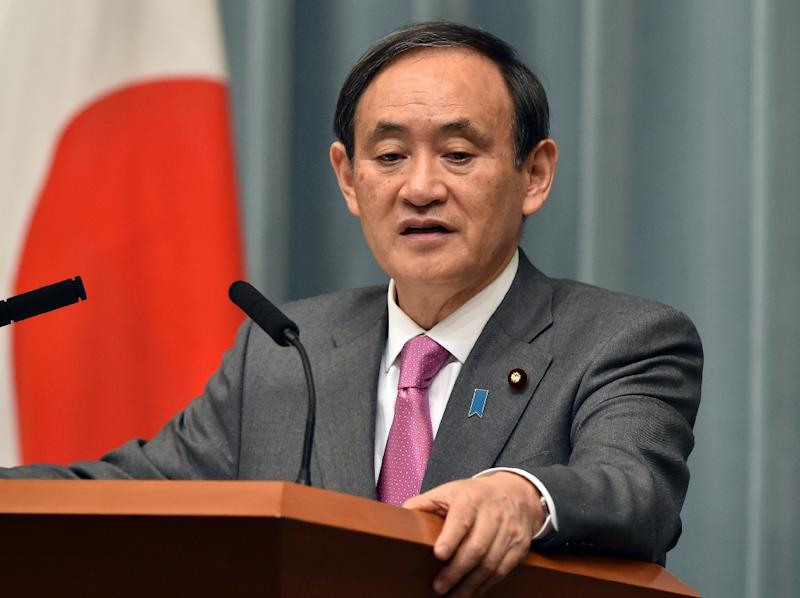 Japan's Chief Cabinet Secretary Yoshihide Suga speaks at a press conference in Tokyo, in March 2015 (AFP Photo/Yoshikazu Tsuno)