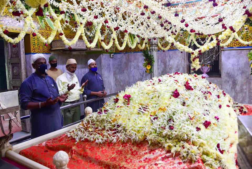Devotees offer prayers at Mahim Dargah that was reopened after remaining closed for months due to the coronavirus pandemic, in Mumbai, Monday, 16 November.