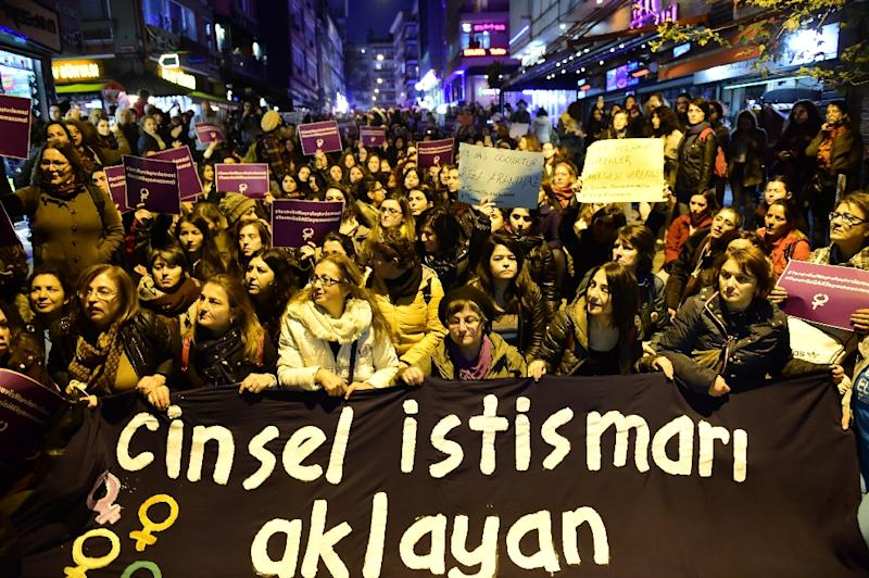 Turkish women protest in Istanbul against a proposed bill that would overturn men's convictions for child sex assault if they married their victim (AFP Photo/Yasin Akgul)