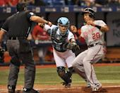 Home plate umpire Manny Gonzalez, left, watches as Tampa Bay Rays catcher Rene Rivera, center, tags out Washington Nationals' Ian Desmond during the fifth inning of a baseball game Tuesday, June 16, 2015, in St. Petersburg, Fla. (AP Photo/Steve Nesius)