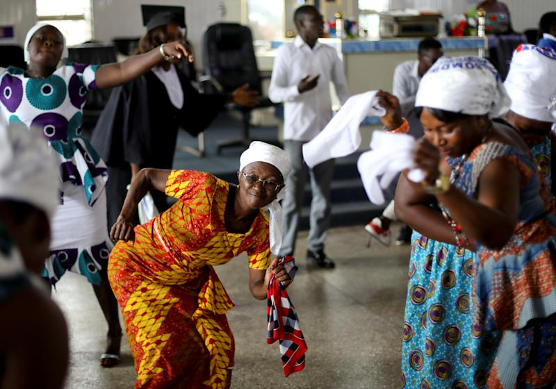 Congregants dance as they attend a church service at Mampong, a small town in the Ashanti region, Ghana. (Photo: Siphiwe Sibeko/Reuters)