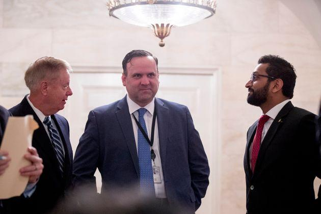 From left, Sen. Lindsey Graham (R-S.C.), White House social media director Dan Scavino, and National Security Council Senior Director of Counterterrorism Kash Patel outside the Diplomatic Room as then-President Donald Trump speaks at the White House on Oct. 27, 2019. (Photo: Andrew Harnik via Associated Press)