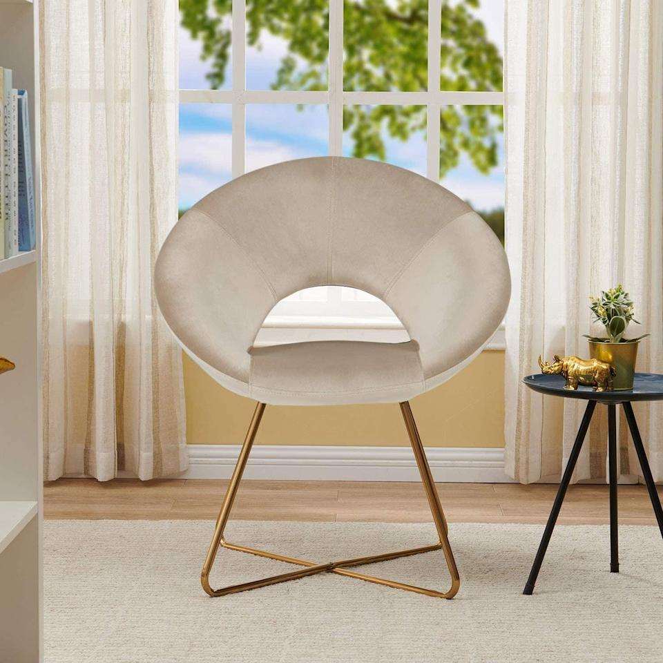 <p>The round bag and golden legs of this <span>Duhome Modern Accent Velvet Chair</span> ($120) bring a dose of elegance that will dominate any room (in the best way). You'll turn this into your go-to spot for reading, lounging, or watching your favorite show.</p>