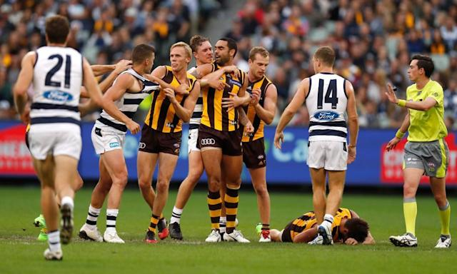 "<span class=""element-image__caption"">In an AFL round rich with symbolism, the sight of club champion Luke Hodge lying prone on the MCG turf was telling for the Hawks.</span> <span class=""element-image__credit"">Photograph: Michael Willson/AFL Media/Getty Images</span>"