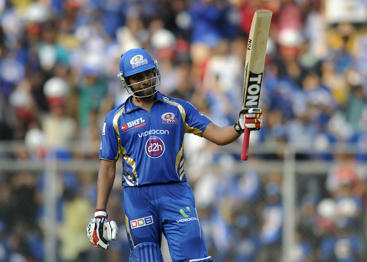 Rohit Sharma of Mumbai Indians raises his bat after scoring a half century during match 15 of the Pepsi Indian Premier League ( IPL) 2013  between The Mumbai Indians and the Pune Warriors India  held at the Wankhede Stadium in Mumbai on the 13th April 2013 ..Photo by Pal Pillai-IPL-SPORTZPICS  ..Use of this image is subject to the terms and conditions as outlined by the BCCI. These terms can be found by following this link:..https://ec.yimg.com/ec?url=http%3a%2f%2fwww.sportzpics.co.za%2fimage%2fI0000SoRagM2cIEc&t=1500972604&sig=mu_zq1j9wAWC1T4SS_2SCQ--~C