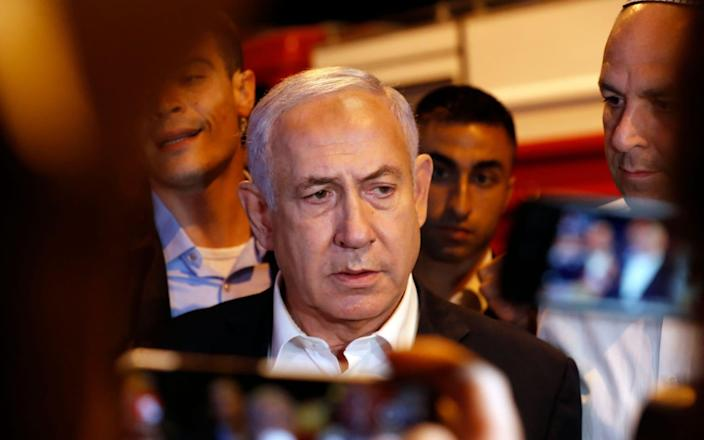 Israeli Prime Minister Benjamin Netanyahu tours the city of Lod early on May 12, 2021 - AFP