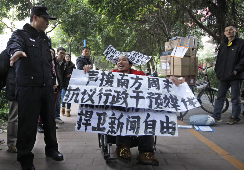 "A supporter of Southern Weekly newspaper in a wheelchair stages a protest outside the headquarters of the newspaper in Guangzhou, Guangdong province, China Wednesday, Jan. 9, 2013. Communist Party-backed management and rebellious editors at the influential weekly newspaper have defused a high-profile standoff over censorship that turned into a test of the new Chinese leadership's tolerance for political reform. The banners read ""Support Southern Weekly, Protest against intervention on media, Defend press freedom."" (AP Photo/Vincent Yu)"