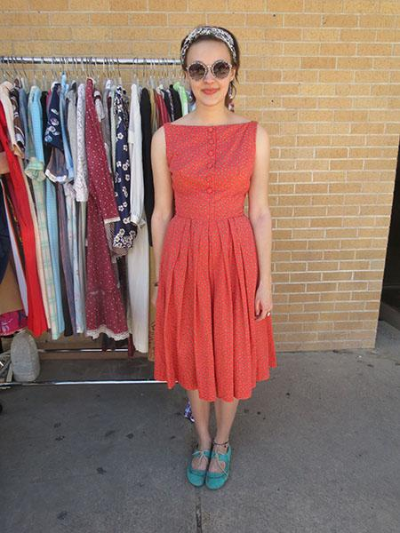 Vintage maven - Is there a more universally-flattering silhouette than an A-line dress with a delicate bateau neckline? Looking at this girl's outfit we're inclined to think no. She took her red, printed dress for a retro spin with robin's egg blue flats, oversized sunnies, and a head scarf that any pin-up would be proud of.