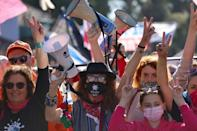 Israelis demonstrate outside Jerusalem district court while Netanyahu attends his hearing on Monday