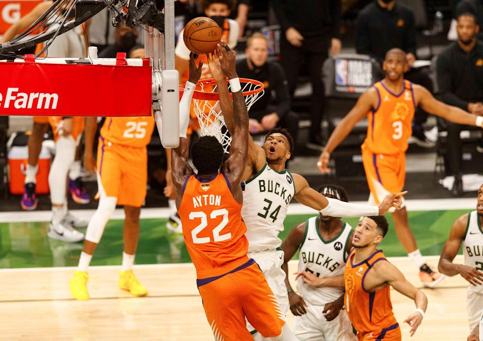 Giannis Antetokounmpo blocks a shot by the Suns' Deandre Ayton during Game 4 of the NBA Finals.