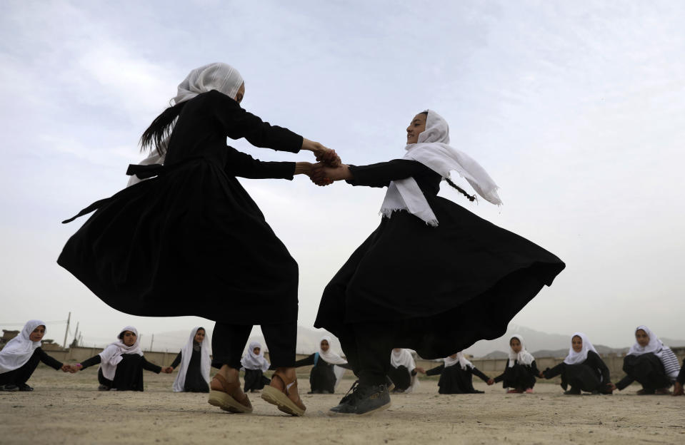 Students play, surrounded by their classmates at a primary school in Kabul, Afghanistan, Saturday, March 27, 2021. (AP Photo/Rahmat Gul)