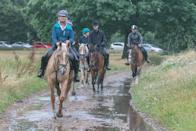 Horse riders on Wimbledon Common on a wet morning (Picture: PA)