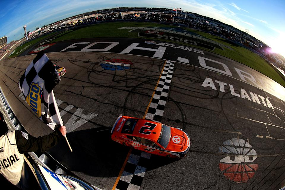 HAMPTON, GA - FEBRUARY 24:  Brad Keselowski, driver of the #2 Autotrader Ford, crosses the finish line to win the Monster Energy NASCAR Cup Series Folds of Honor QuikTrip 500 at Atlanta Motor Speedway on February 24, 2019 in Hampton, Georgia.  (Photo by Sean Gardner/Getty Images)