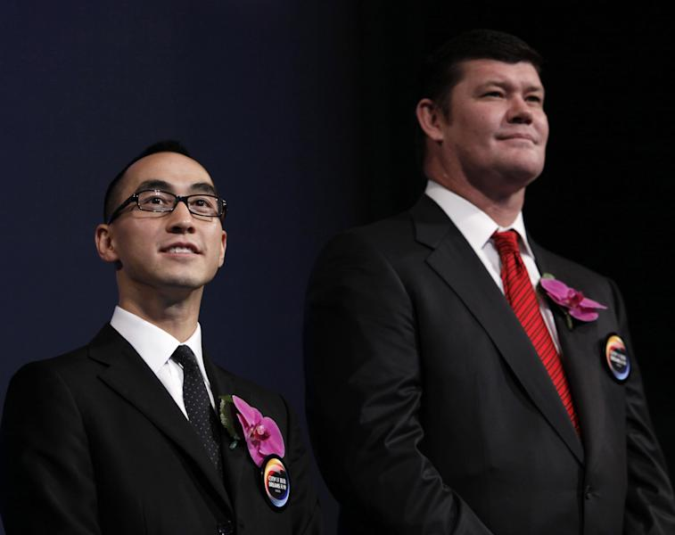 In this photo taken on Monday, June 1, 2009, James Packer, right, co-chairman and a Director of Melco Crown Entertainment, and Lawrence Ho, co-chairman and CEO of Melco Crown Entertainment, attend the ribbon cutting ceremony for the City of Dreams, one of the giant casino complex in Macau. Macau gambling company Melco Crown Entertainment is teaming up with the Philippines' richest man to develop a $1 billion Manila casino resort in a sign of the industry's plans for rapid expansion in Asia. Melco said late Thursday, July 5, 2012 it will develop the project with three companies controlled by Philippine tycoon Henry Sy. Melco is jointly controlled by Ho, who is the son of Macau casino king Stanley Ho, and by James Packer, the son of late Australian media magnate Kerry Packer. (AP Photo/Kin Cheung)