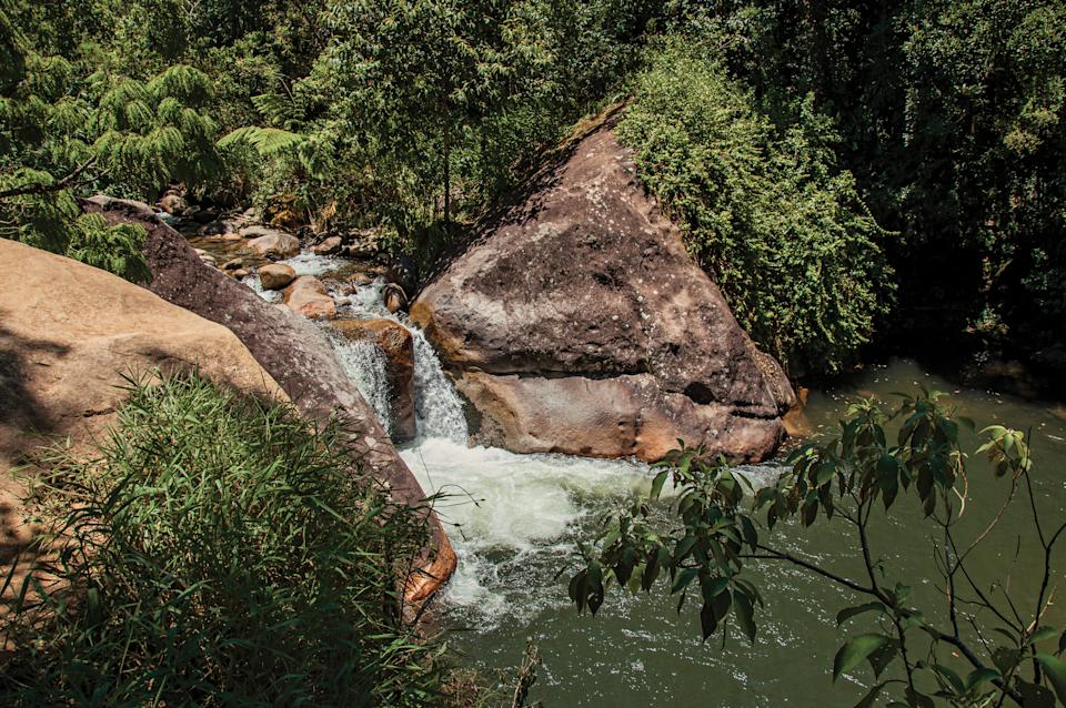 View of waterfall and cliff in the middle of a forest in Visconde de Mauá, a village in the mountains with cold climate and perfect days for hiking. In the Rio de Janeiro State, southwestern Brazil