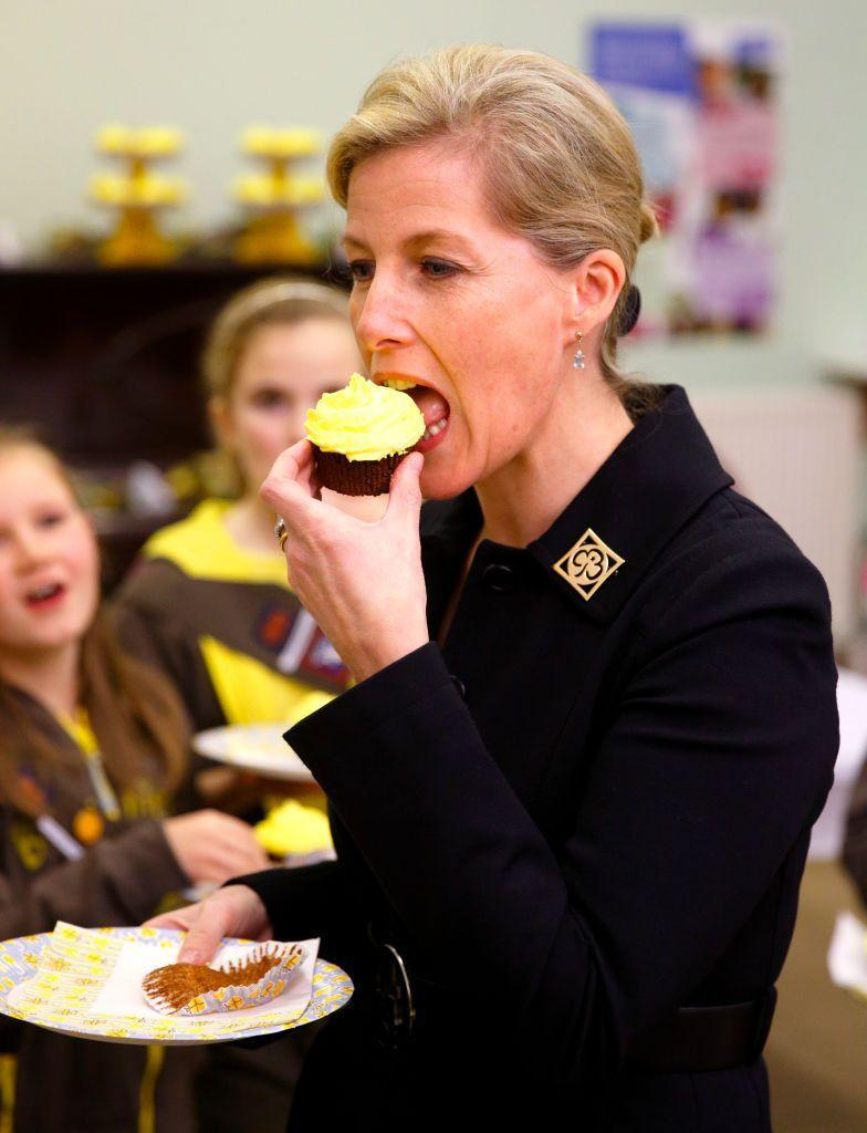 <p>The Countess bit into a yellow cupcake while visiting Frimley Brownies in Frimley, England. </p>