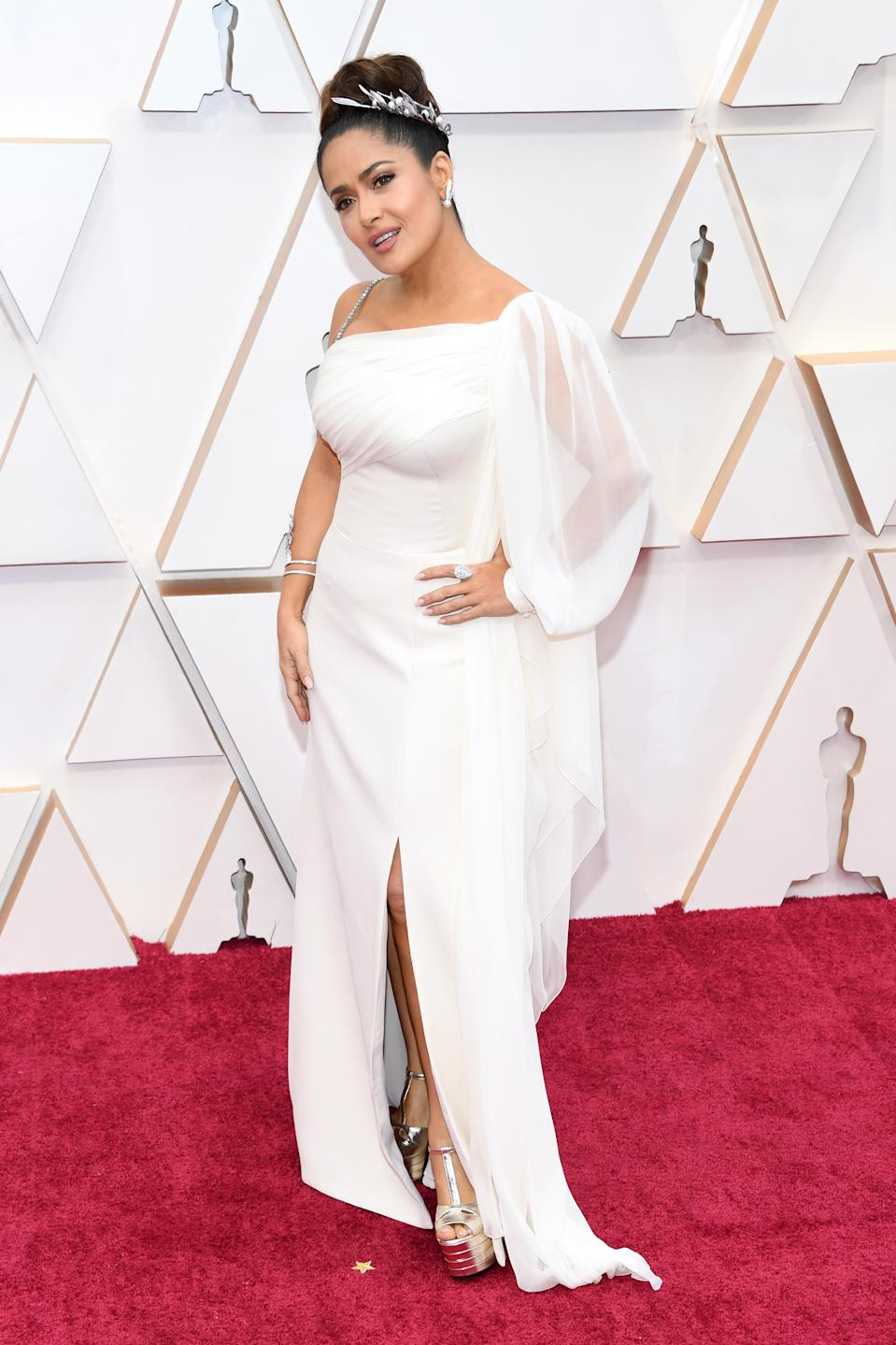 Hayek looked like a goddess in a Grecian-inspired look by her go-to designer Gucci.