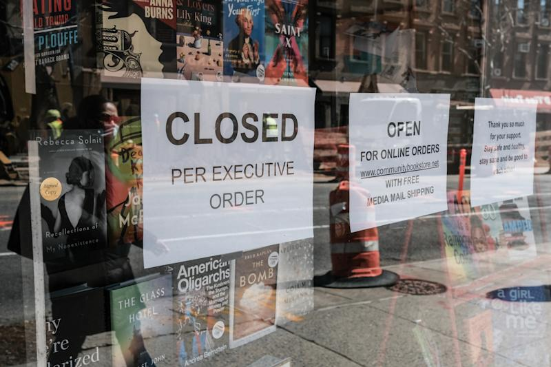A sign explaining that a bookstore will remain closed, due to the outbreak of the coronavirus disease (COVID-19) in the Brooklyn borough of New York City, U.S., March 26, 2020. REUTERS/Stephen Yang