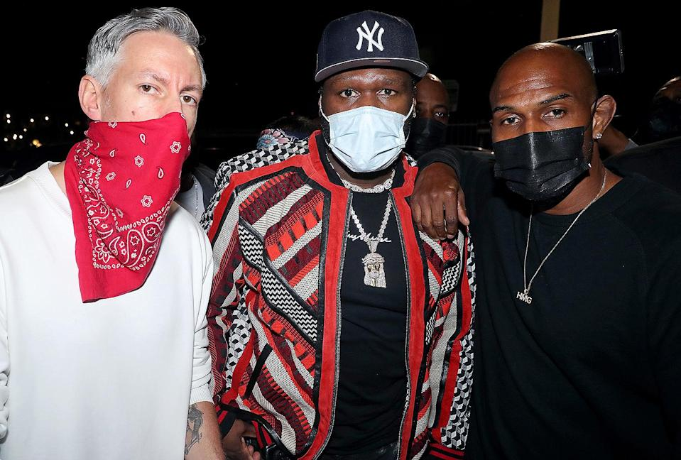 <p>50 Cent (center) hosts a party for Barry Mullineaux (left) on Thursday in Miami, Florida. </p>