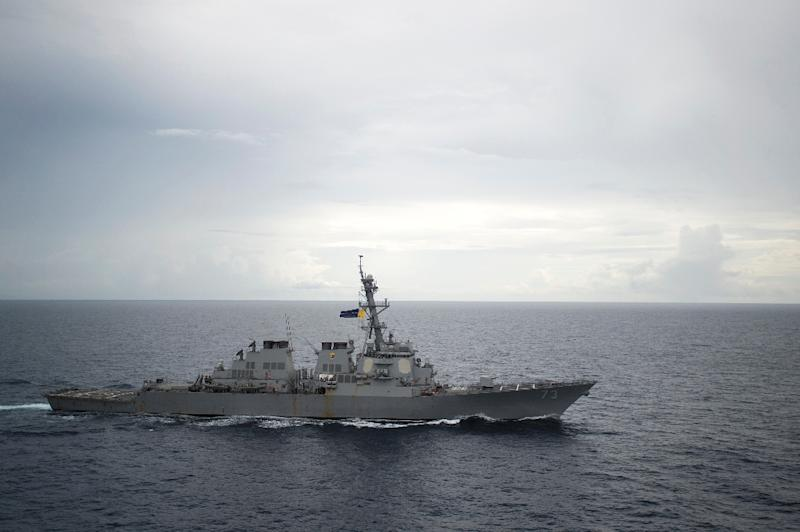 U.S. warship sails through waters off disputed islets