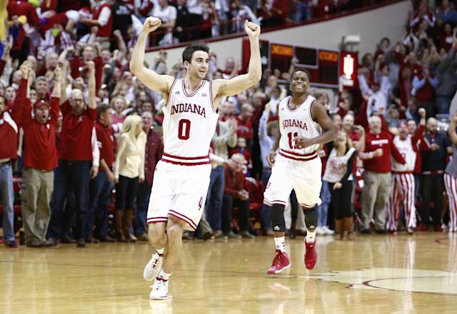 "Indiana guards Will Sheehey (0) and Kevin ""Yogi"" Ferrell run on the court late in the second half of an NCAA basketball game against Wisconsin in Bloomington, Ind., Tuesday, Jan. 14, 2014. Indiana won 75-72. (AP Photo/R Brent Smith)"