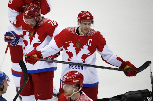 Russia defenseman Andrei Markov, left, and forward Pavel Datsyuk react after Russia lost 3-1 to Finland in a men's quarterfinal ice hockey game at the 2014 Winter Olympics, Wednesday, Feb. 19, 2014, in Sochi, Russia. (AP Photo/Mark Humphrey)