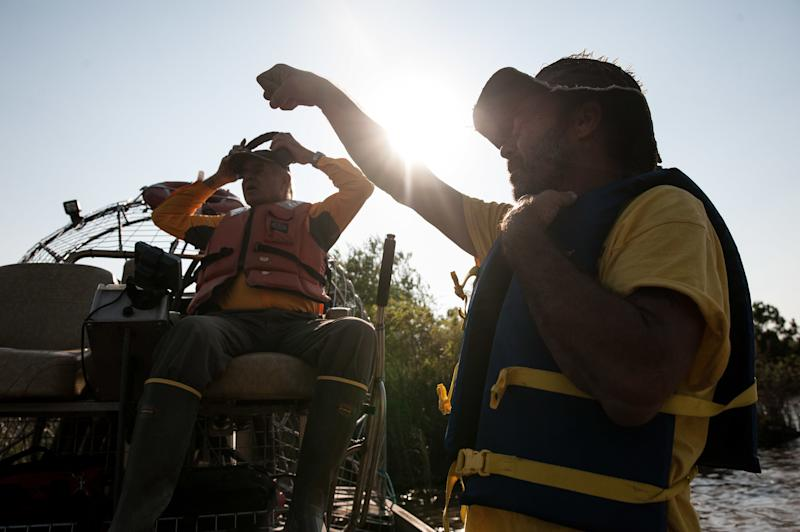 Volunteer searchers use side scan sonar in Cedar Bayou. (Joseph Rushmore for HuffPost)
