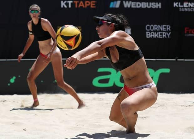 Melissa Humana-Paredes, right, and Sarah Pavan, left, are shown in this July 2020 file photo. The Canadian duo dropped their bronze-medal match in straight sets at the Ostrava Beach Open on Sunday. (File/AVP via Getty Images - image credit)