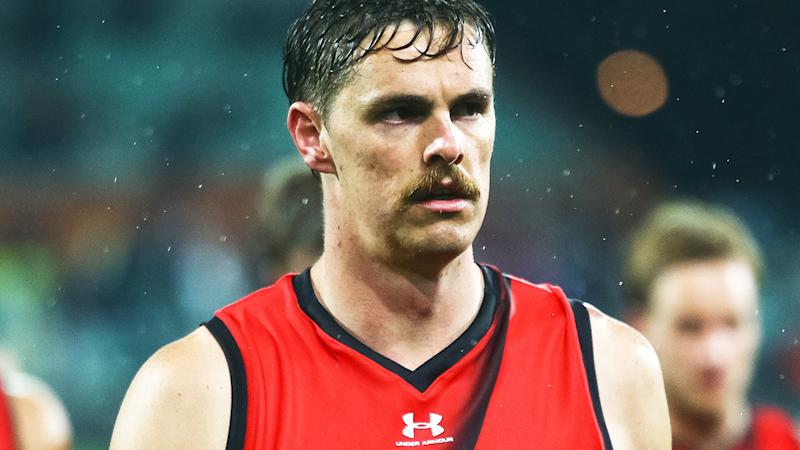 Essendon's Joe Daniher is pictured walking off the ground after an AFL match against Port Adelaide.