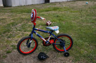 """A """"Captain America"""" themed children's bicycle is seen during a voter registration drive at a largely Latino trailer community in Burlington, N.C., Wednesday, March 11, 2020. (AP Photo/Jacquelyn Martin)"""