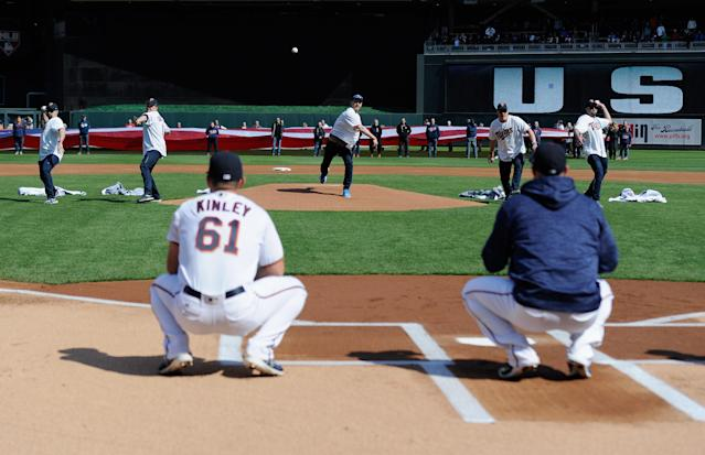 The United States men's curling team threw out the first pitch on Thursday at the Minnesota Twins home opener. (Getty Images)