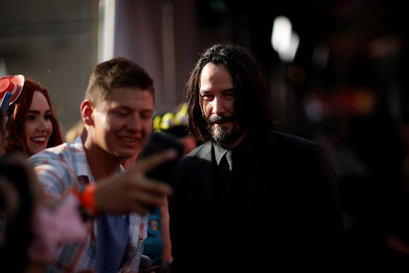 "Actor Keanu Reeves takes a photo with fans at the premiere for ""Toy Story 4"" in Los Angeles, California, U.S., June 11, 2019. REUTERS/Mario Anzuoni"