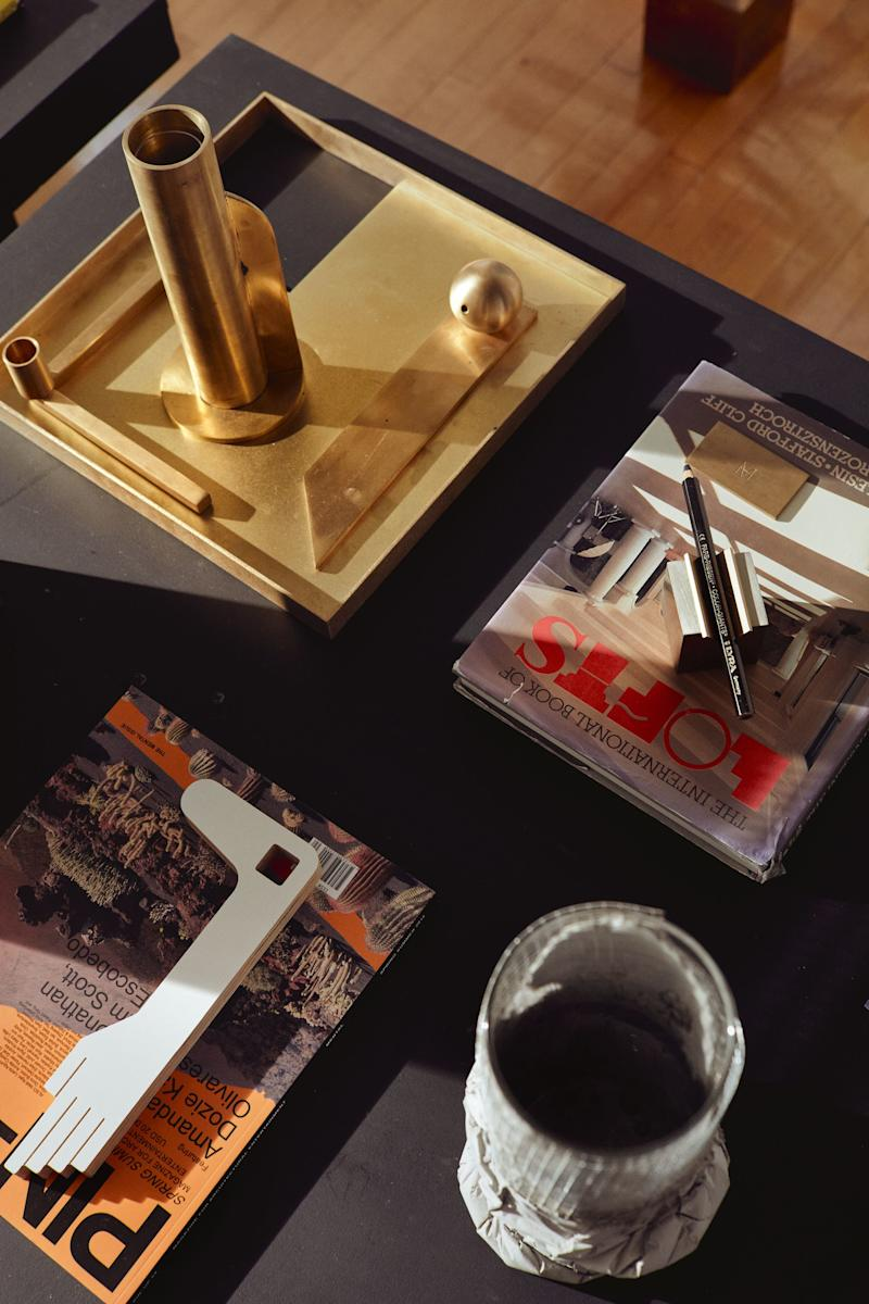Inspirational objects cover the desk at Material Lust's SoHo studio.