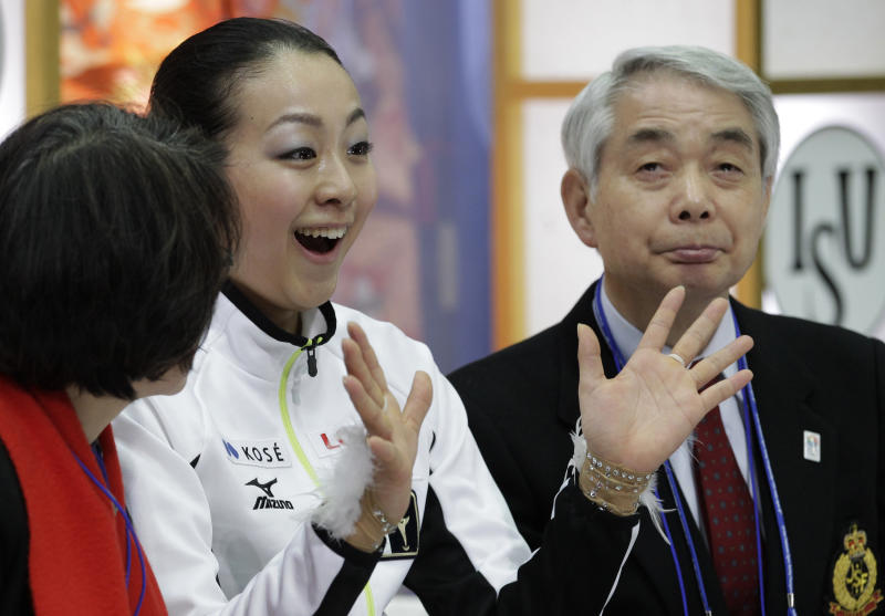Mao Asada of Japan reacts after her performance during the women's free skating event at the ISU Four Continents Figure Skating Championships in Osaka, western Japan, Sunday, Feb. 10, 2013. (AP Photo/Shizuo Kambayashi)