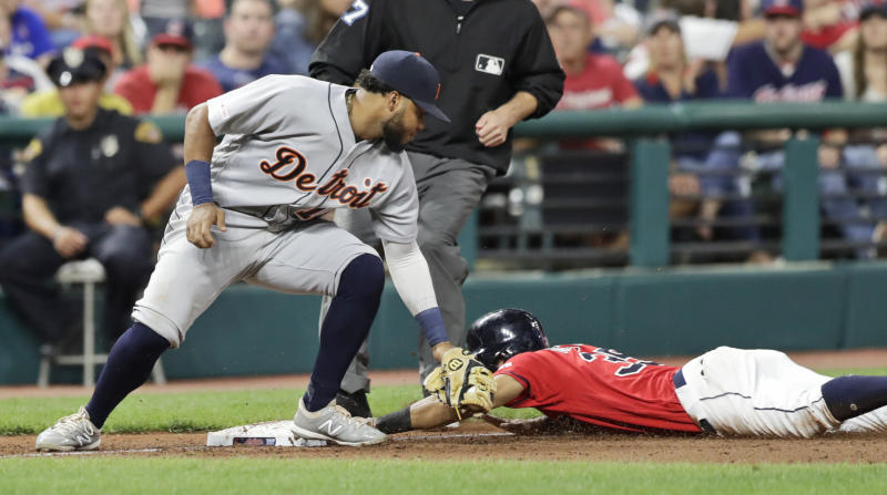 Cleveland Indians' Oscar Mercado, right, steals third base as Detroit Tigers' Dawel Lugo is late on the tag in the fifth inning in a baseball game Thursday, Sept. 19, 2019, in Cleveland. (AP Photo/Tony Dejak)