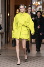 <p>The model and wife of Justin Bieber attended the 'Americans in Paris' cocktail party wearing a neon yellow coat dress by Matthew Adams Dolan. <em>[Photo: Getty]</em> </p>