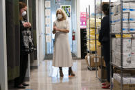 First lady Jill Biden, center, speaks with Kim Thiboldeaux, left, CEO of the Cancer Support Community, and Naseema Shafi, right, CEO of Whitman-Walker Health, during a tour of Whitman-Walker Health Friday, Jan. 22, 2021, in Washington. (AP Photo/Jacquelyn Martin, Pool)