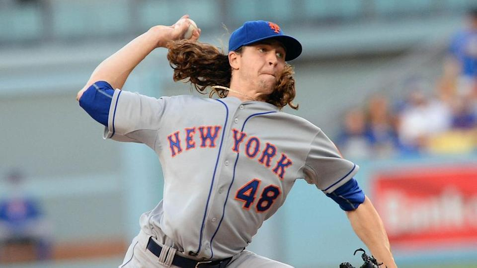 October 15, 2015; Los Angeles, CA, USA; New York Mets starting pitcher Jacob deGrom (48) pitches the second inning against Los Angeles Dodgers in game five of NLDS at Dodger Stadium.