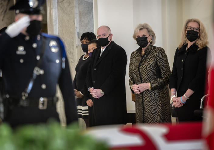 Gov. Larry Hogan, center, with wife Yumi, left, stands with family members of the late Senate President Emeritus Thomas V. Mike Miller, Jr., under the dome of the statehouse at the Maryland Statehouse in Annapolis, Md., on Friday, Jan. 22, 2021. Miller was a state legislator for 50 years. A Democrat, he served as president of the Maryland Senate for 33 years. He announced he was stepping down from the post in 2019, but he remained a senator until December. (Bill O'Leary/The Washington Post via AP, Pool)